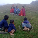 Children-watching-as-women-are-interviewed-for-Doko-Radio
